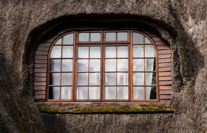 Jackie Cameron School building -- thatched roof window detail