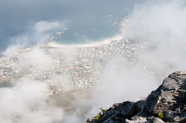 A view of Cape Town from Table Mountain with the fog blowing by