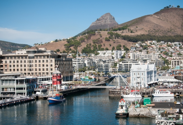 The modernized V&A Waterfront of Cape Town's Harbour with Lion's Head in the distance