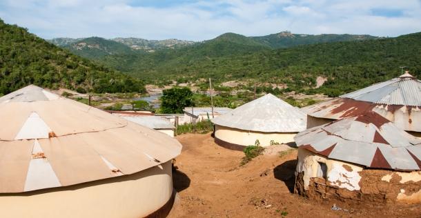 Traditional Zulu homes in foreground, Inanda region, near Durban, South Africa