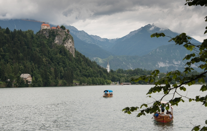 Bled Castle, set on a high rock monolith, towers over Lake Bled, Slovenia