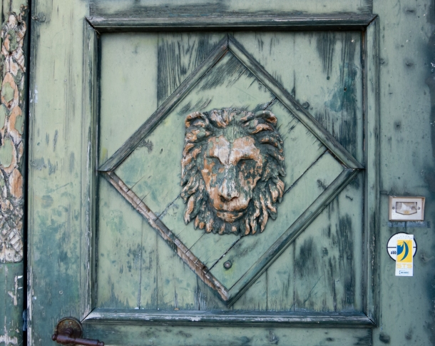 Carved lion's head on door, Trieste, Itlay