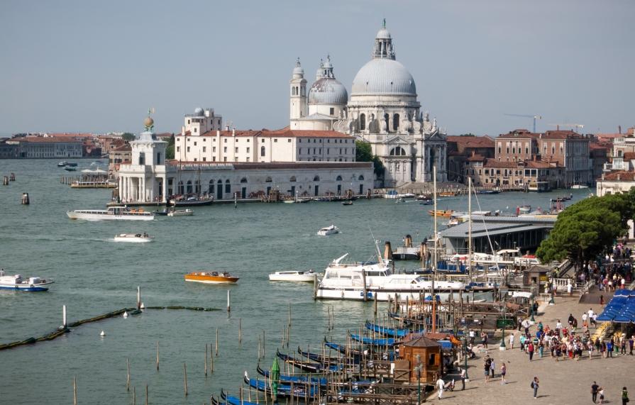 Entering the Canal Grande (Grand Canal) by the Basillica di Santa Maria della Salute (Basilica of St. Mary of Health), Venice, Italy
