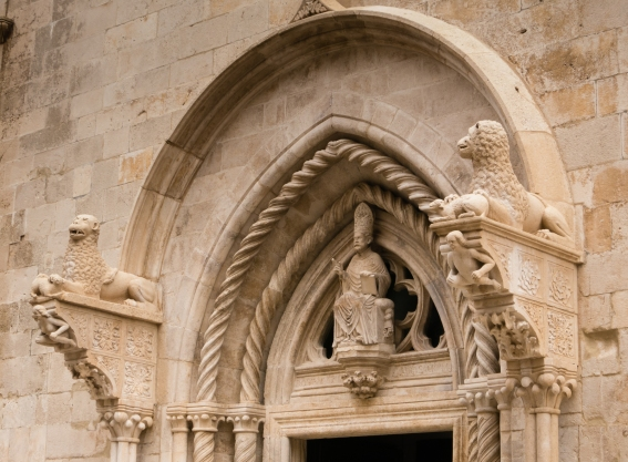 Entry portal to Katedrala Sv. Marka with St. Mark and two Venetian winged lions of St. Mark in Old Town Korcula, Croatia