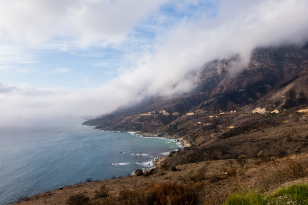 Fire charred hillside of Chapman's Peak Drive, overlooking Hout Bay