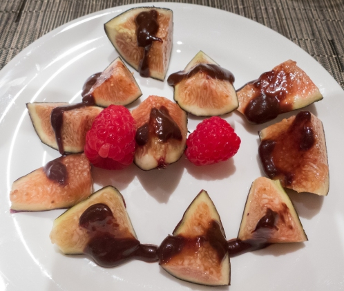 Fresh figs and raspberries with hot fudge sauce for dessert -- dinner in our apartment, sailing out of Venice, Italy