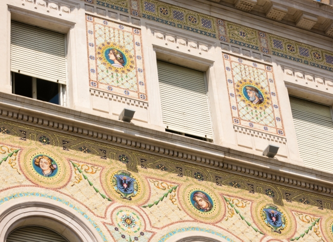Gold leaf and inlaid mosaic details on overnment building in the Piazza dell' Unita d' Italia, Trieste, Itlay