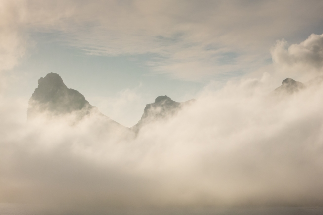 Hout Bay mountains peeking through the enveloping evening fog_