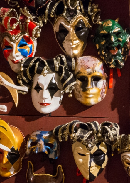 Masks in a storefront window, Venice, Italy