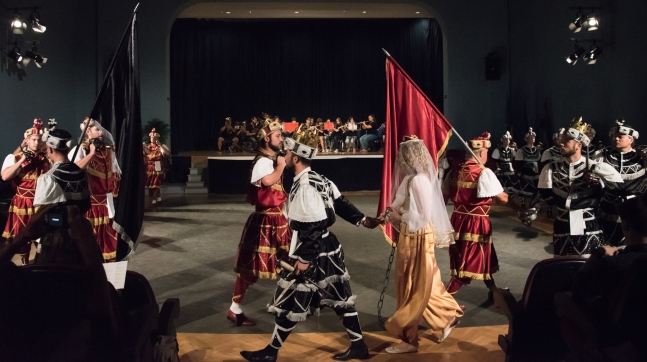 Moreska (sword dance) performed in Korcula, Croatia-  The Black King drags the Bula (the Muslim woman) in chains