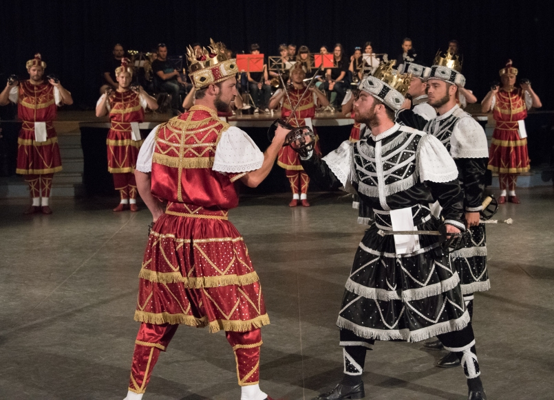 Moreska (sword dance) performed in Korcula, Croatia-  The Red King and Black King cross swords, preparing for battle
