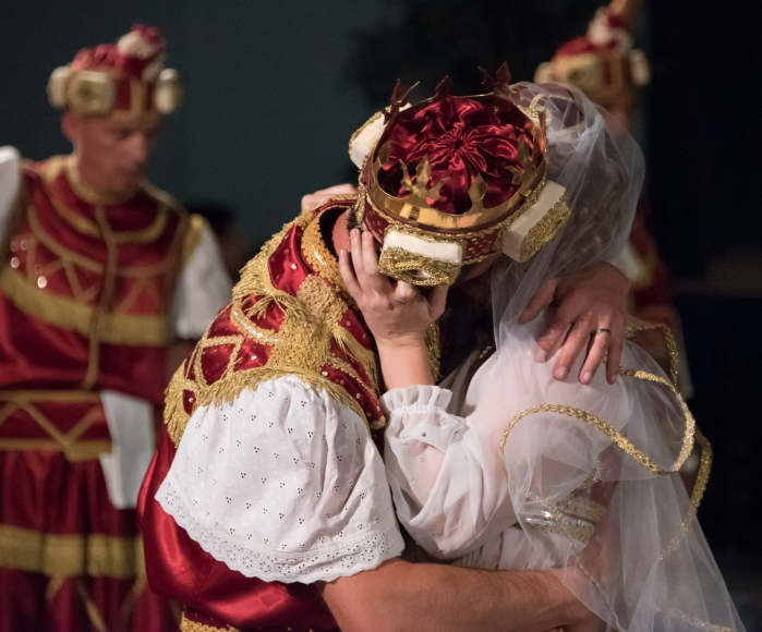 Moreska (sword dance) performed in Korcula, Croatia-  The victorious Red King kisses the Bula