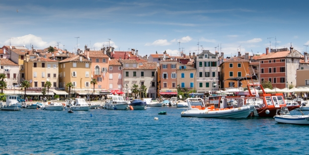 Multi-colored houses line the harbor on the edge of Old Town Rovinj, Croatia