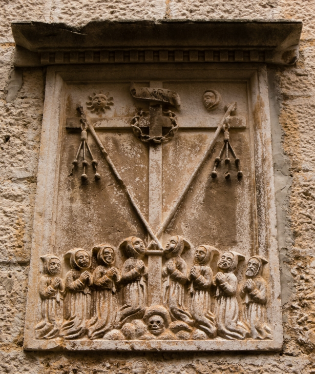 Sculpture on embedded in house wall in Old Town Korcula, Croatia