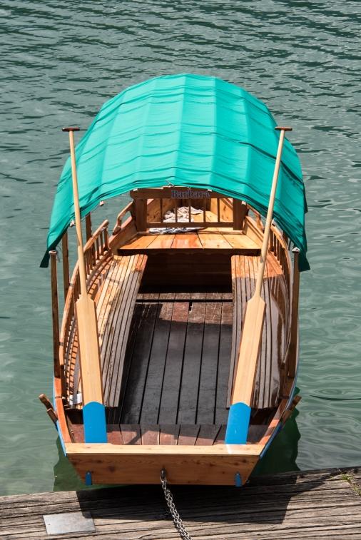 Traditional wooden plenta (oared boats) on Lake Bled, Slovenia