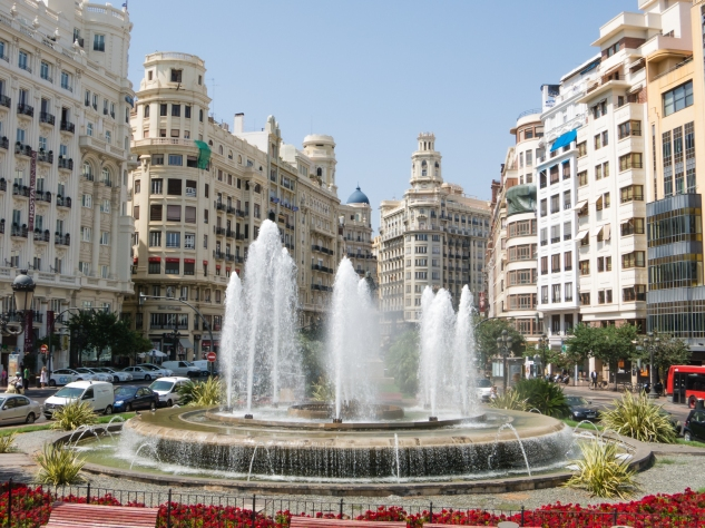 A typical city plaza, with a fountain, in downtown Old Town, Valencia, Spain