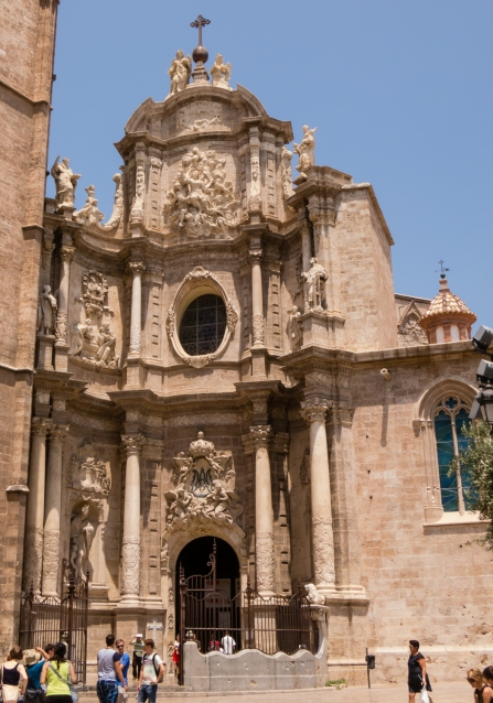 Baroque-style entrance to the Valencia Cathedral from the Plaza de la Reina, Valencia, Spain