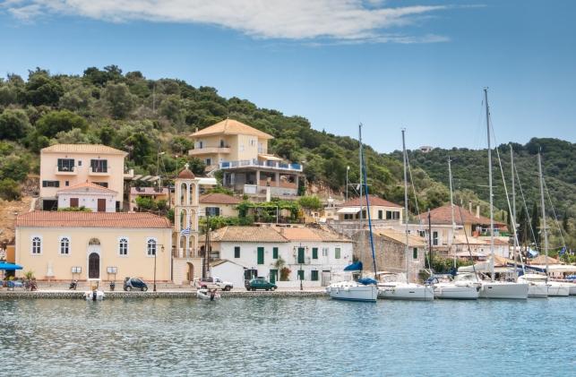 Church and small private harbor on Meganisi Island, southeast of Lefkada island, Greece