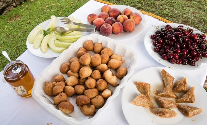 Dessert buffet- fried homemade dough balls with honey, melon, peaches, cherries and homemade baklava