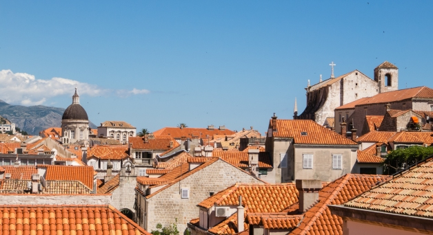 Dubrovnik rooftops viewed from city wall with St. Ignatius Loyola on the right (south) side
