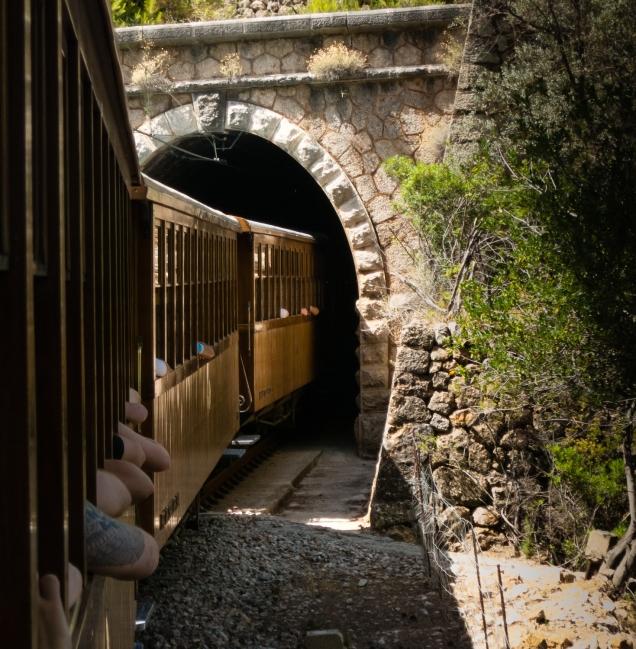 Entering one of 13 tunnels on the Sóller to Palma de Mallorca ride on the Ferrocarril (narrow-guage railway) de Sóller, Mallorca, Spain