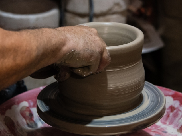 First step in making ceramics -- shaping the clay on a potter's wheel, Ceramica Vallencia, Manises, Valencia, Spain