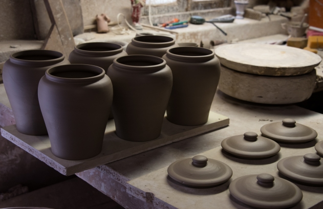 Handcrafted jars and lids drying before first kiln firing, Ceramica Vallencia, Manises, Valencia, Spain