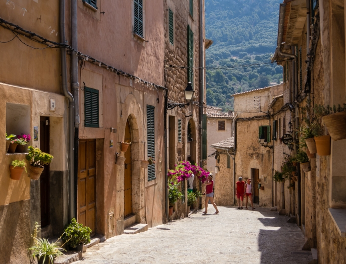 Hillside street with homes and shops in Valldemossa, Mallorca, Spain