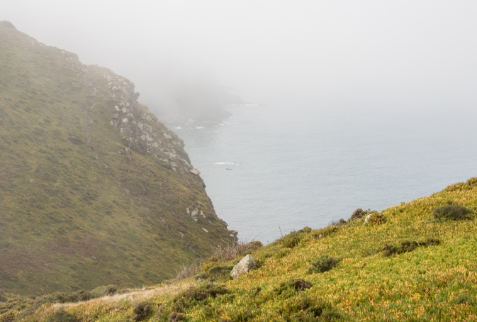 Looking westward on a foggy day from Cabo da Roca, Continental Europe's westernmost point, Portugal