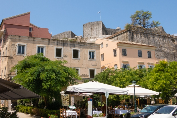 Outdoor cafe and Neo Frourio (the New Fortress-Citadel) in the background, Corfu, Greece
