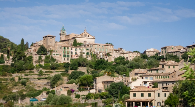 The Royal Carthusian Monastery and King Sancho Palace (left, center) in the Tramuntana Mountains village of Valldemossa, Mallorca, Spain