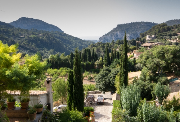 View of the Tramuntana Mountains and Valldemossa from the monks' cells at the Real Cartuja de Valldemossa (the Royal Carthusian Monastery), Valldemossa, Mallorca, Spain