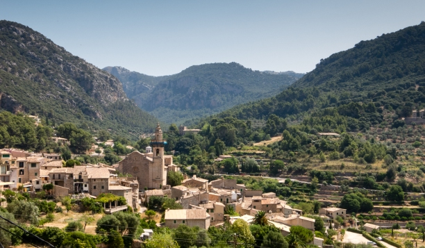 View of Valldemossa village and Catholic church set against the Tramuntana Mountains, Mallorca, Spain