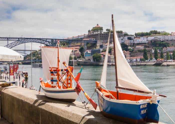Boat models on the quay overlooking the Rio Douro (Douro River), Porto, Portugal