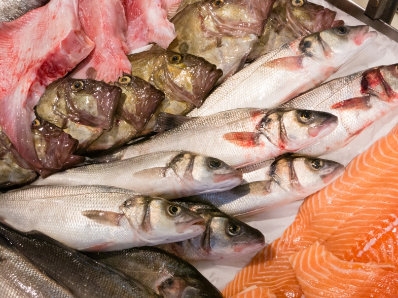 Fresh fish at fishmonger's stall inside at Marché Aux Halles (Central Market), La Rochelle, France