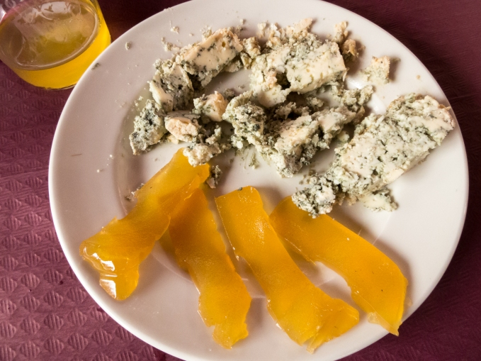 Local blue cheese and membrillo with a glass of sidra (apple cider) at a cafe in Tazones, Asturias region (near Gijon), Spain