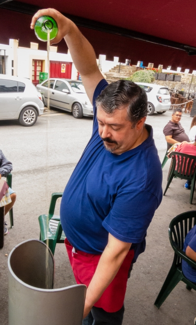 Pouring local sidra (apple cider) at a cafe in Tazones, Asturias region (near Gijon), Spain
