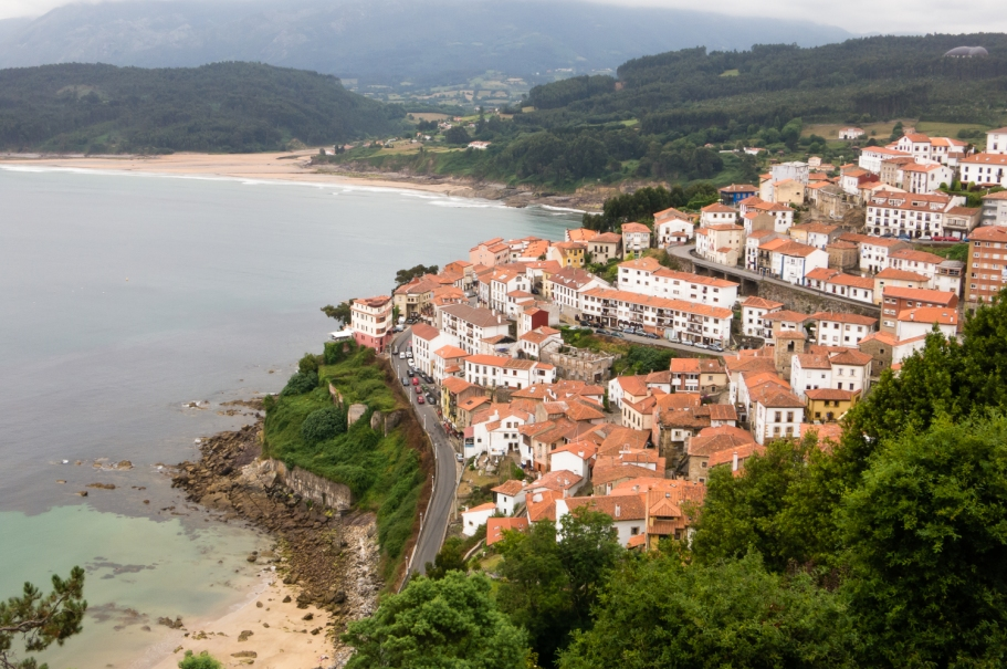 Viewpoint overlooking the fishing town of Lastres and the Sierra del Sueve mountains, Asturias region (near Gijon), Spain