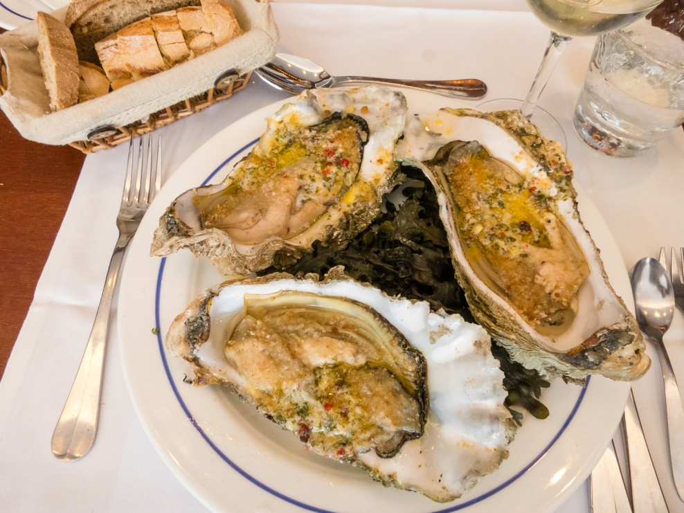 Baked oysters, a la carte first course at L'Amiral Restaurant, Concarneau, France