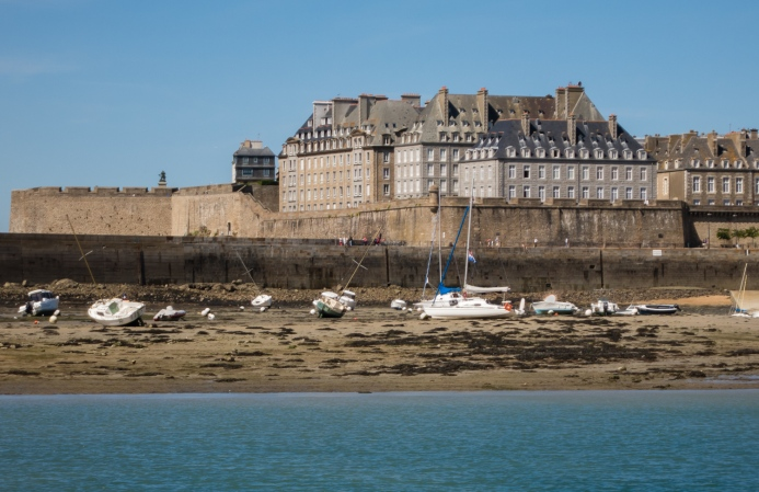 Boats in the sand by La Ville Intra-Muros (Walled City), Saint-Malo, France, viewed from the west at low tide