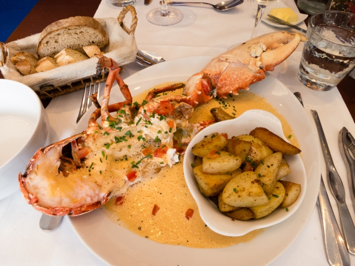 Boiled fresh lobster with L'Amiral sauce, a la carte main course at L'Amiral Restaurant, Concarneau, France