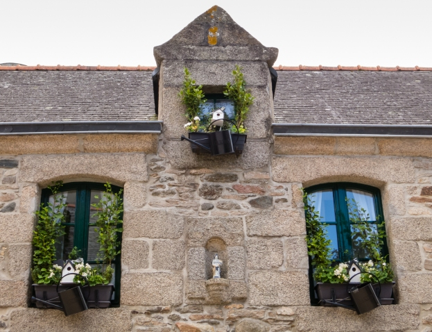 Local stone facade of private home with personalized window boxes in Ville Close (Walled City), Concarneau, France