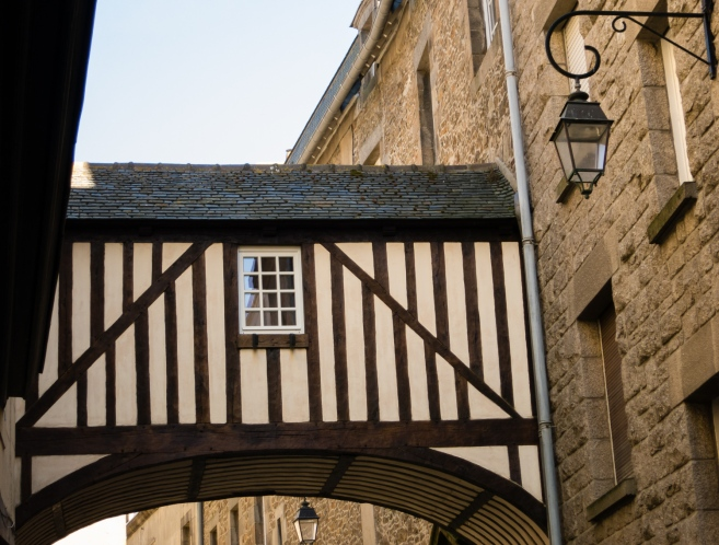 "One of the few remaining half-timbered ""bridges"" connecting old buildings, Saint-Malo, France"