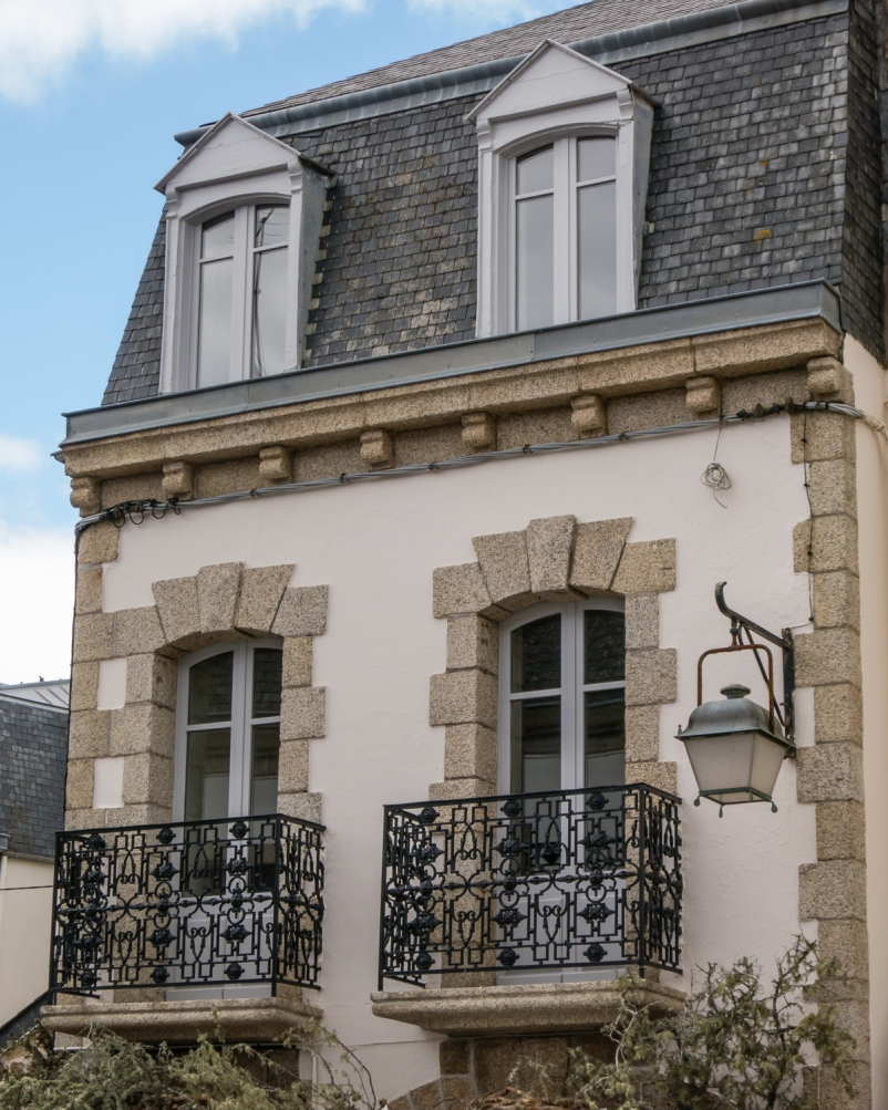 Traditional architecture home with local stone decoration in Ville Close (Walled City), Concarneau, France