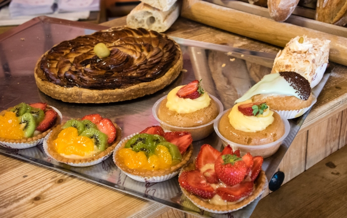 Traditional French pastries and baguettes at patisserie in La Ville Intra-Muros (Walled City), Saint-Malo, France