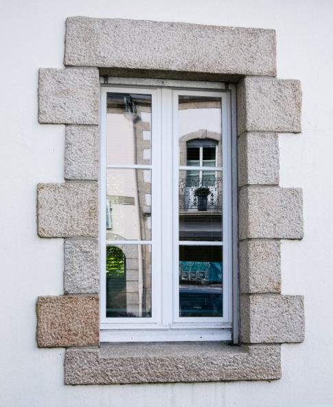 Typical local stone-framed window on home, Pont-Aven, Brittany, France