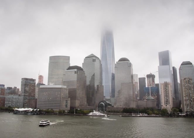 Battery Park and the new Freedom Tower (hidden in the clouds), New York, New York, USA