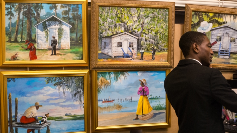 Contemporary paintings of plantation slavery scenes (on sale in Charleston City Market), Charleston, South Carolina, USA