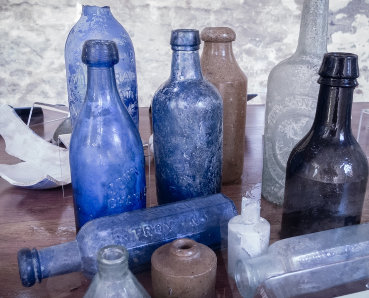 Glass bottles and pottery fragments found under floorboards in slave cabins at Boone Hall Plantation, Charleston, South Carolina, USA