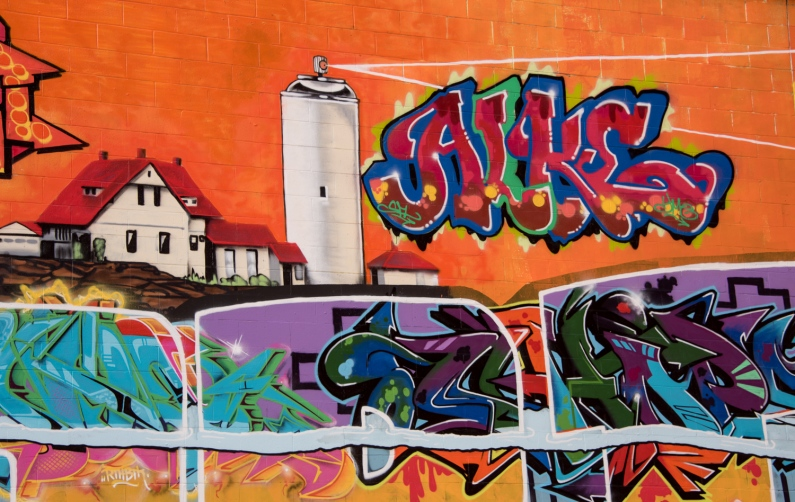 Graffiti wall featuring Portland Head Light, Portland, Maine, USA